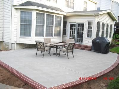 Traditional Concrete Patio With Faux Brick Edge I Would Use A Dark Grey  Brick Edge