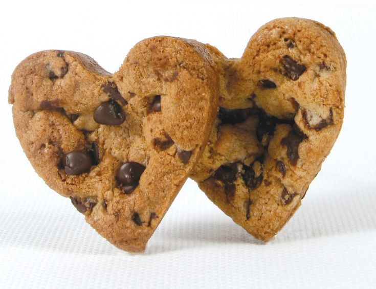 Heart-shaped chocolate chip cookies. Who doesn't love chocolate chip cookies, especially when they are heart-shaped! Easy to make, and have a loving effect.