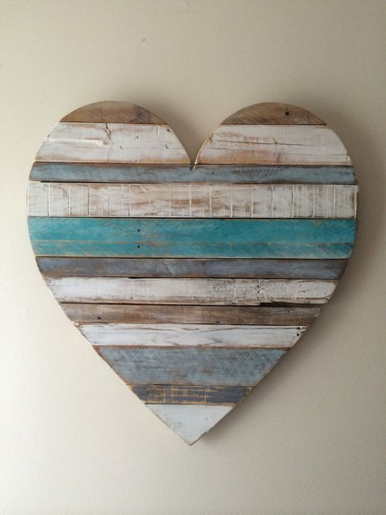 Our Beach cottage inspired heart is hand painted with teals, blue grays and whites. This unique rustic heart is designed and made by hand in our shop