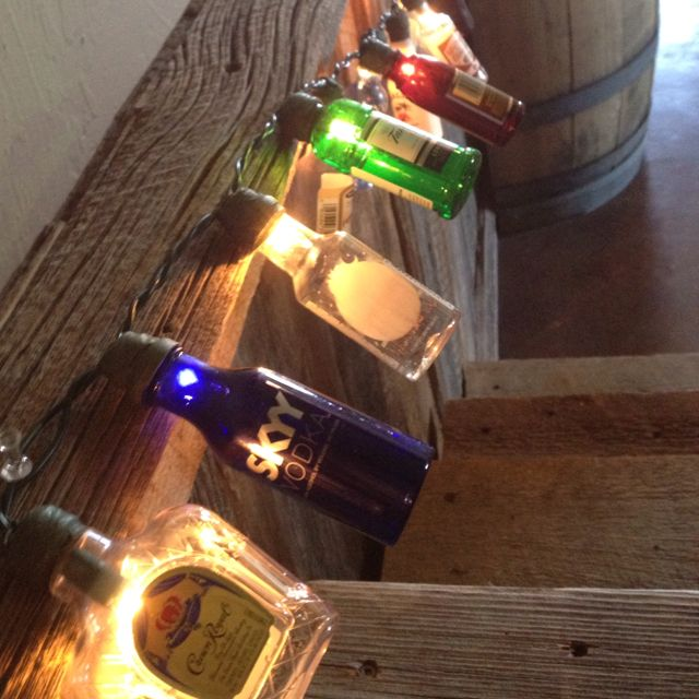 Mini liquor bottle string lights @ Neely Miller.  Enjoy!!!  www.jennsthisandthat.com