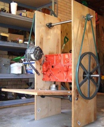 Two or more people can generate electricity from a recycled auto alternator using the treadle-powered generator. Photo courtesy of Pat Delany