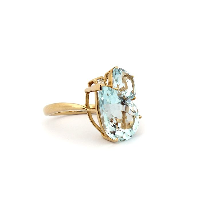 Atmosphere Cluster Ring  This beautiful ring is made using eye clean Aquamarine pear shape and cushion cut gemstones and Diamonds.    What's your Atmosphere? Dare to be different!