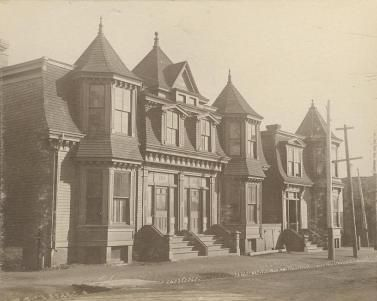 Cica 1900 - Rowhouses at North street and Robie street. Today the east portion of the house in the forefront has been removed and an addition has been added between the two buildings