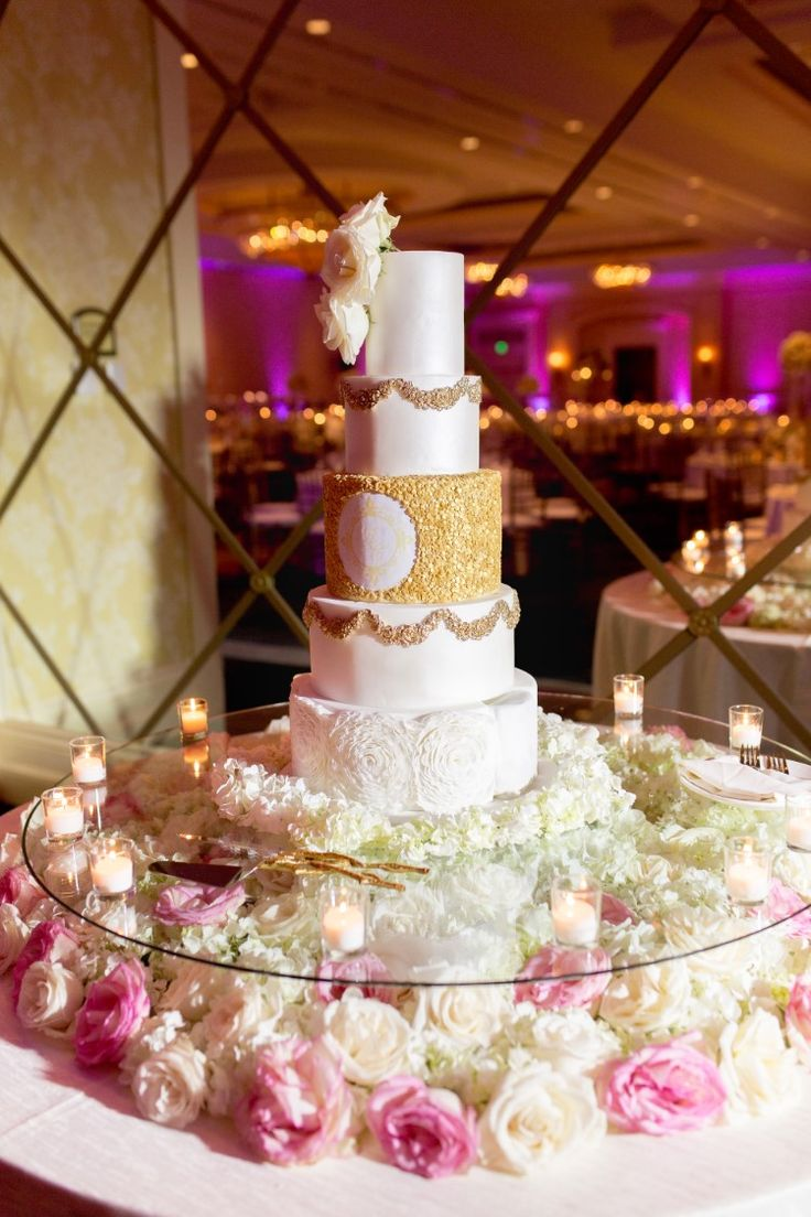 wedding cakes in lagunbeach ca%0A Breathtaking luxury  glamorous wedding cake table filled with flowers and a  gorgeous four tier white