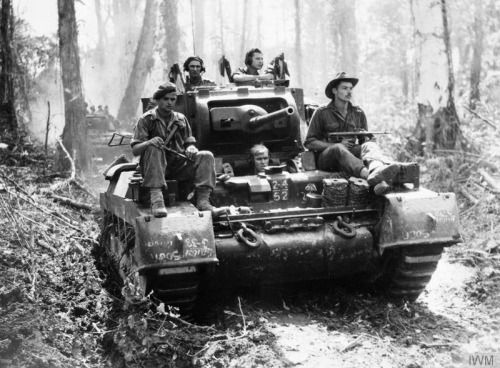 A Matilda tank of 'B' Squadron, 2/4th Australian Armoured Regiment, with supporting infantry moving along the Buin Road, south of the Hongorai River during mopping-up operations on Bougainville in the Solomon Islands.