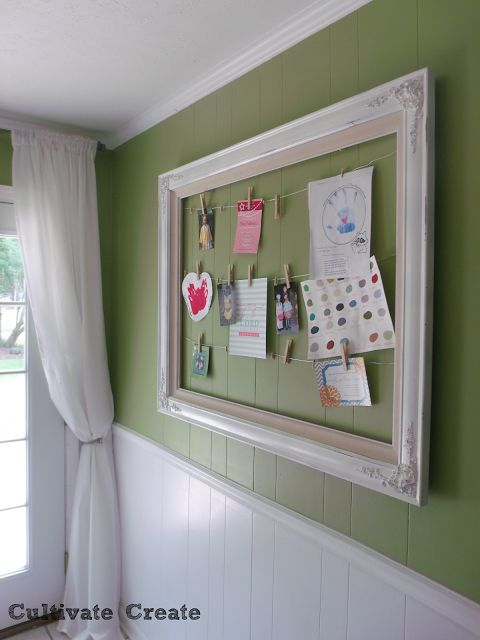 Use a large frame to hand kid's artwork, invitations, or Christmas cards.