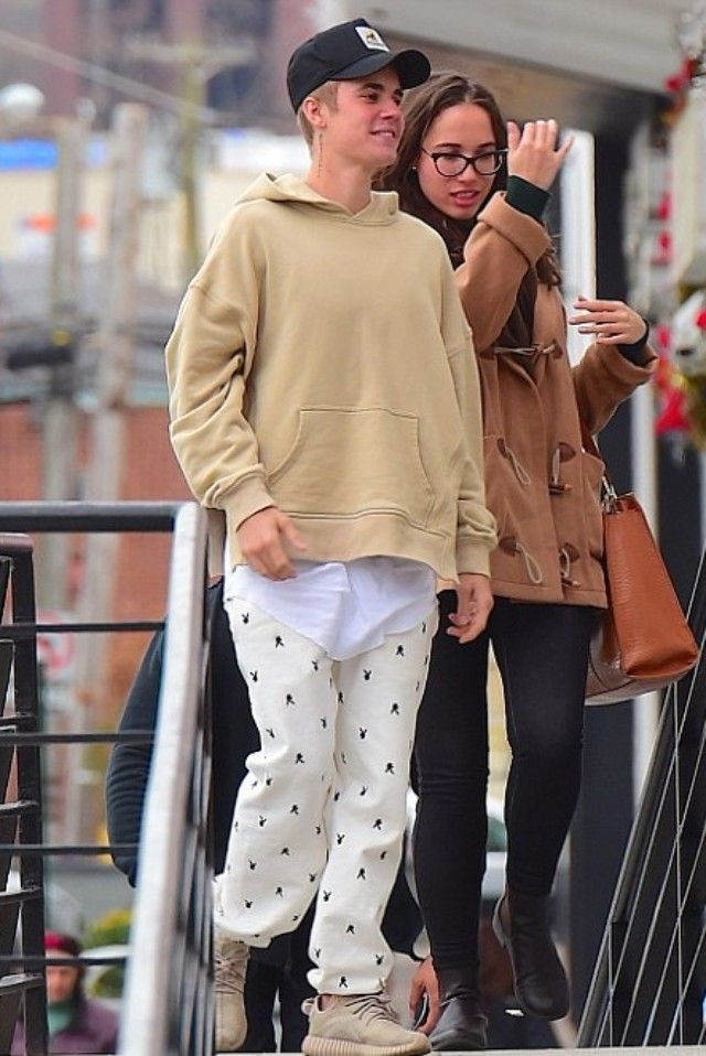 Justin Bieber wearing  Supreme Playboy Sweatpants , Adidas Yeezy Boost 350 , Fear of God The Everyday Hoodie, New Era XXLarge Patch D-frame Trucker Cap