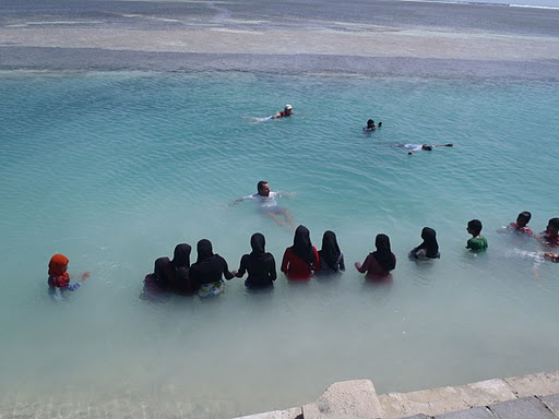 Teach locals how to swim in the Maldives