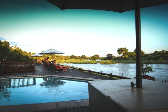 Sabie River Bush Lodge in Hazyview. Located on the banks of the Sabie River and overlooking the Kruger National Park to one side. 12 Luxury rooms with en-suite and air conditioners and 3 self catering Luxury bush tents.