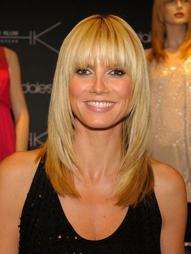 Famous Mom Heidi Klum With Her Dramatic-Angeled Bangs.