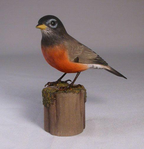 Hand-craved robin. Bird