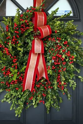 Beautiful boxwood and berries wreath from Sweet Something Designs   Friday Christmas Favorites at www.andersonandgrant.com
