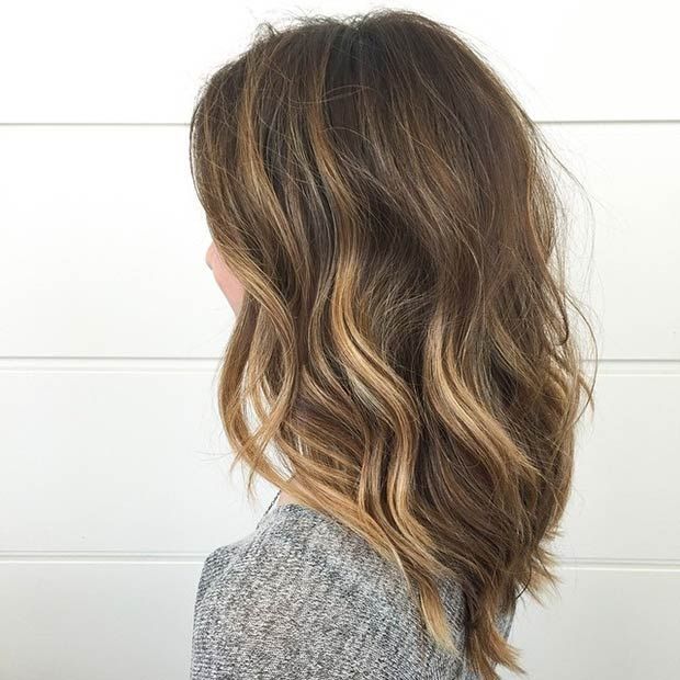RICH BROWN LOB WITH A POP OF HONEY HIGHLIGHTS This hairstyle will make you look like a bombshell! Have your stylist add some honey highlights to your hair to brighten up the face. Layers give this stunning lob an illusion of a thicker hair.