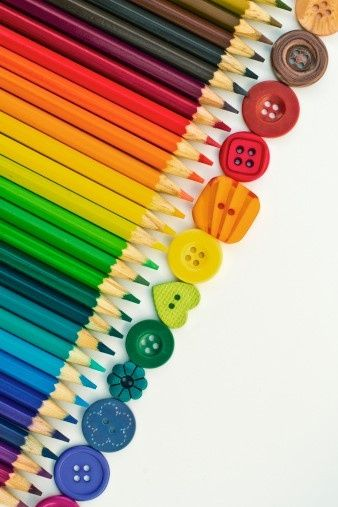 Rainbow buttons and colored pencils