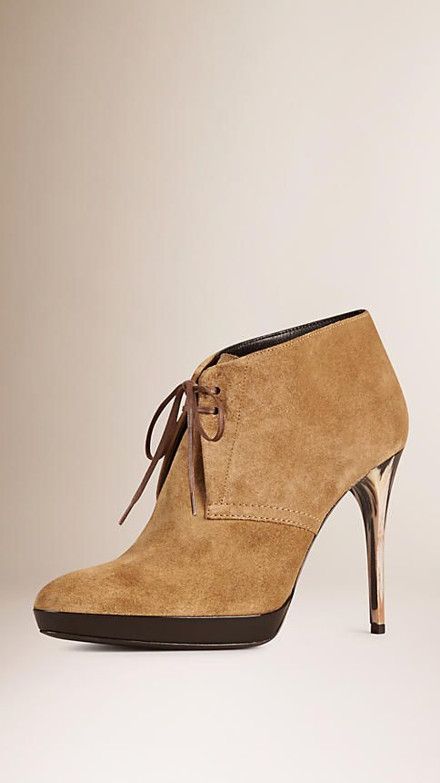 Burberry Italian-made ankle boots in suede with a lace-up closure. Discover the shoes at Burberry.com