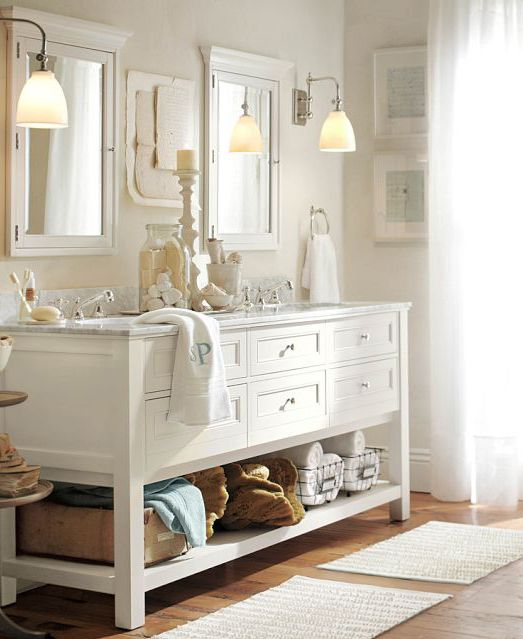Cottage White--solid hardwood, double sink console w/Carrara marble; individual mirrors and light fixtures; wire storage underneath.