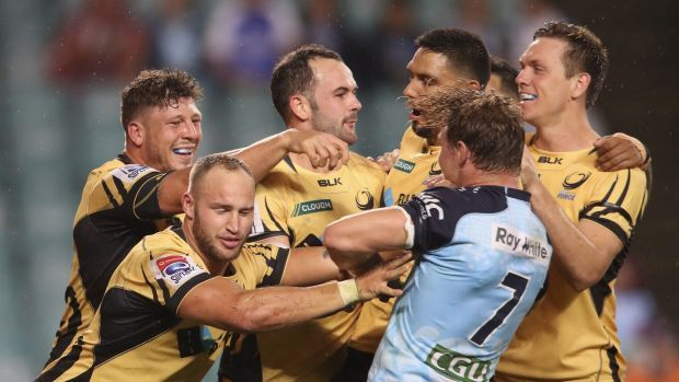 Plenty of feeling: Force players scuffle with Michael Hooper as they celebrate a Jono Lance try.