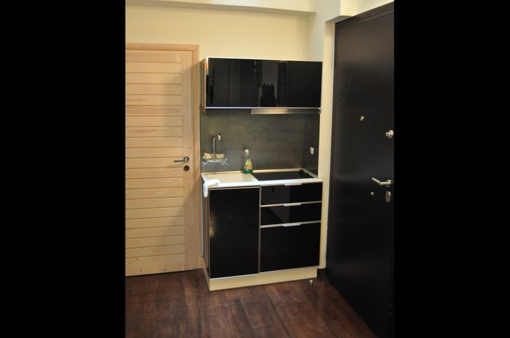 Custom made kitchen units, interior design, black laquered cupboards
