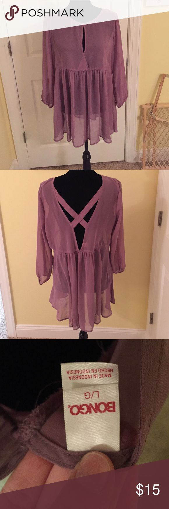 Purple shirt Super cute purple shirt. In great condition. Super cute!! Has a cross cross back design too! BONGO Tops Blouses