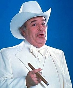 "Sorrell Booke -- (1/4/1930-2/11/1994). Stage/Screen/Voice/Television Actor. He portrayed Jefferson Davis 'Boss' Hogg in ""The Dukes of Hazzard"". Movies -- ""What's Up, Doc?"" as Harry, ""Freaky Friday"" as Mr. Dilk, ""Mastermind"" as Max Engstrom, ""The Cat from Outer Space"" as Judge and ""Special Delivery"" as Hubert Zane. He died from Colorectal Cancer at age 64."