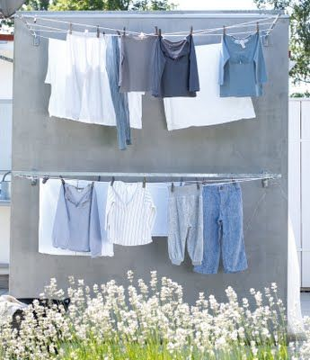 Scandinavian Retreat . outdoor shower with a back side drying rack .