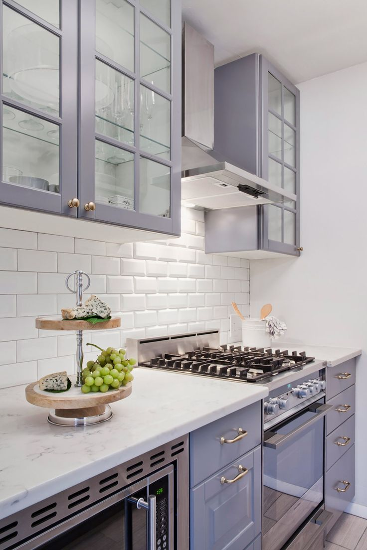 Grey IKEA cabinetry paired with white subway makes for a perfect small kitchen space