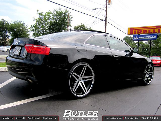 Audi A5 with aftermarket wheels.