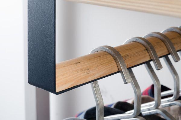 Cloths Rack: Bent steel strap and wood. Bent metal hangers.