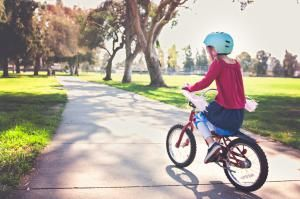 Girl riding bike in the park - Teresa Short/Moment/Getty Images