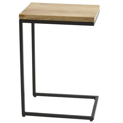 """Takat C-Table, $100. """"Tuck the foot under a sofa or chair for instant dining wherever you want. Or slide the top over a side arm as a home for drinks or remotes. The sturdy black iron frame and warm mango wood tabletop are at home almost anywhere."""""""