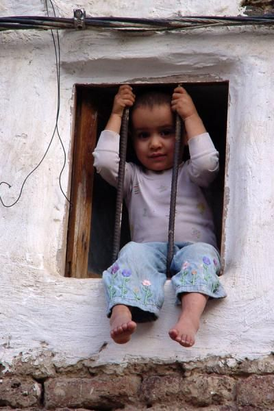 Picture of Small child in window in San'a - Yemen - Asia