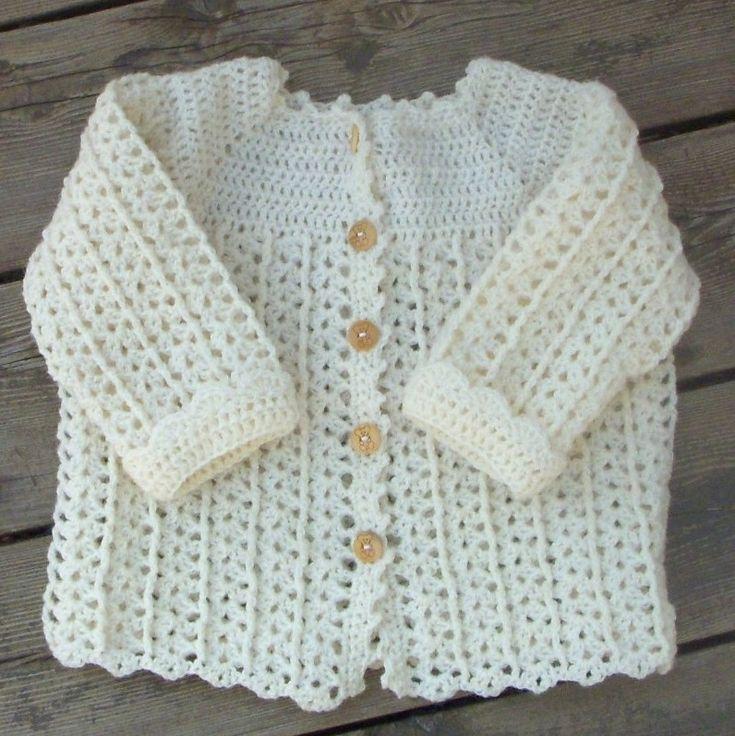 Sød hæklet babytrøje med en lille snoning Str. 3 - 6 mdr. Forbrug: 100 - 150…