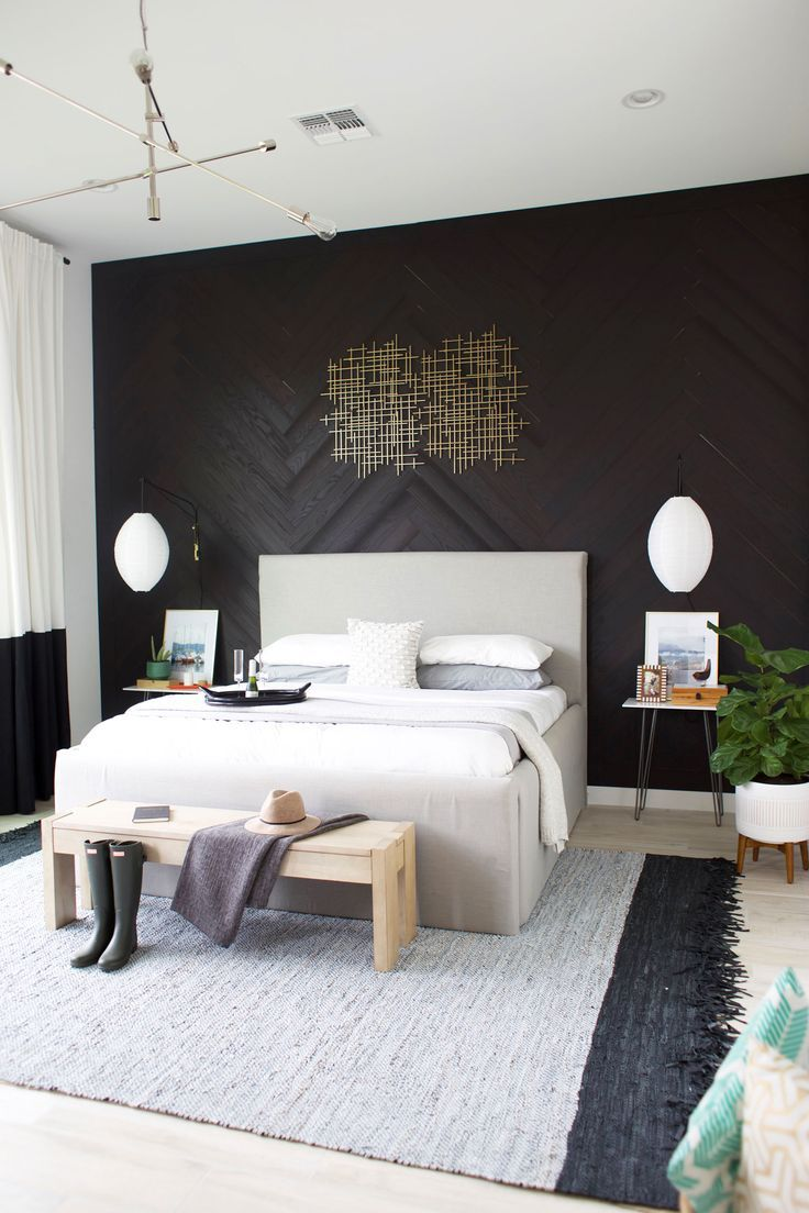 Our master bedroom reveal + a DIY herringbone wood wall tutorial.