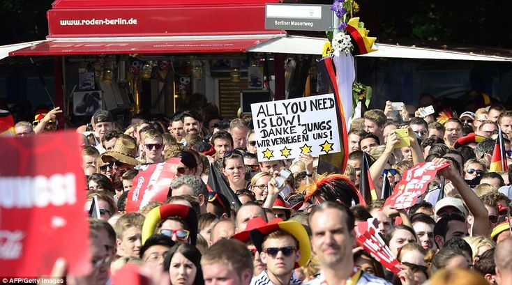 Nice take: One fan raises a banner reading 'all you need is Low, we take a bow' before the...