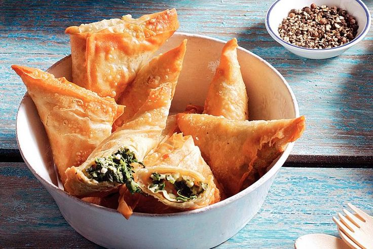 Delicious Greek Spanakopita's ! 10 sheets of filodough spinach, white cheese, spicy cheese, 1/2 tsp nutmeg. Done !!