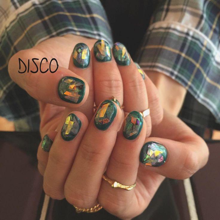 Glittery nail art. Green nail polish.