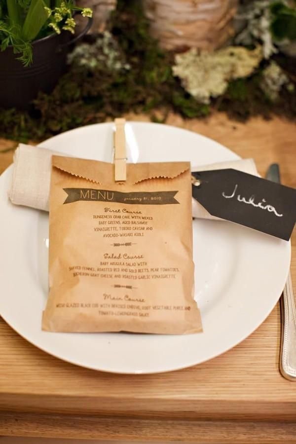 This modern menu includes a place card, favor and, of course, a list of what's for dinner. Place a sweet treat or other edible favor into the brown menu bag to give your guests a little surprise when they take their seats. @myweddingdotcom