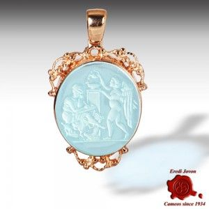 MURANO GLASS INTAGLIOS CAMEO TRINKET GOLD SET  Intaglios aquamarine color glass cameo trinket. The silver red gold plated frame, finely filigree worked, embellishes the pendant with a rich neoclassic set. The scene engraved portrays Venus and Eros in a peaceful moment. The minuteness of intaglio let you distinguish clearly every detail, even water drops spurting from a pitcher.  https://www.eredijovon.com/en/2687-murano-glass-intaglios-cameo-trinket-gold-set.html