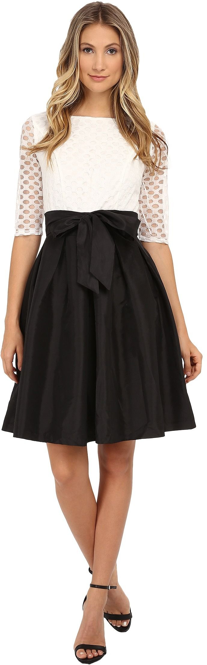 Beautiful black and white dress with see-through top and bowtie belt