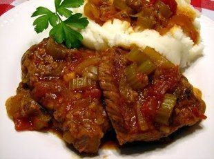 Yoder's Swiss Steak. 2 lb beef round steak  3/4 c flour  1 tsp salt and pepper  3 Tbsp vegetable oil  1 1/2 c chopped celery  1 md green pepper, chopped  1 lg onion, chopped  1 can(s) 16 oz. tomato sauce  2 c beef broth  1 tsp kitchen bouquet,   covered at 325 for 2 hrs.