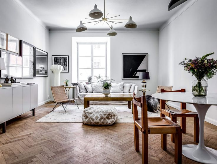 White painted modern livingroom. Scandinavian decor ideas and how to choose pendant according to ceiling height.