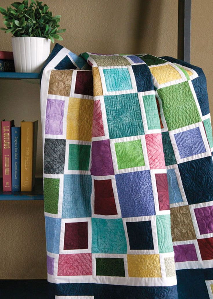 Deceptively simple throw features creative construction and wow color.