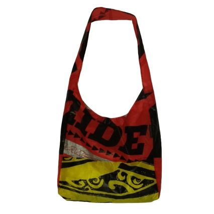 "This Fold Up Messenger/Hobo Bag can tuck into its own built in pocket (4""x5"") to fit perfectly in your glove compartment or purse.  Made from recycled kite surf sails straight from Maui!"