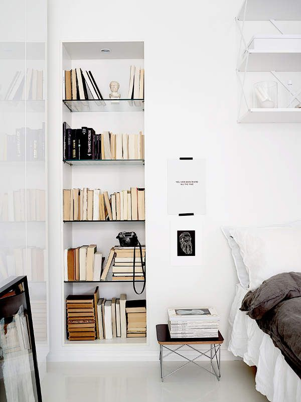 Bedroom with small bookcase white Scandinavian bedroom