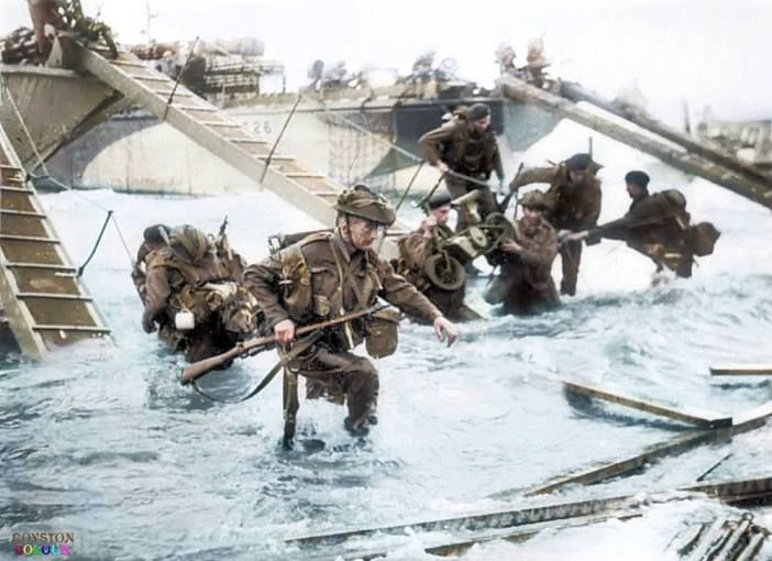 British Commandos of HQ 4th Special Service Brigade, 48th Royal Marines coming ashore from LCI(S) landing craft at 'Nan Red Sector' Juno Beach, Saint-Aubin-sur-mer, Normandy, France, at approximately 0845 on D-Day, 6th June 1944. (Colorized by Royston Leonard)