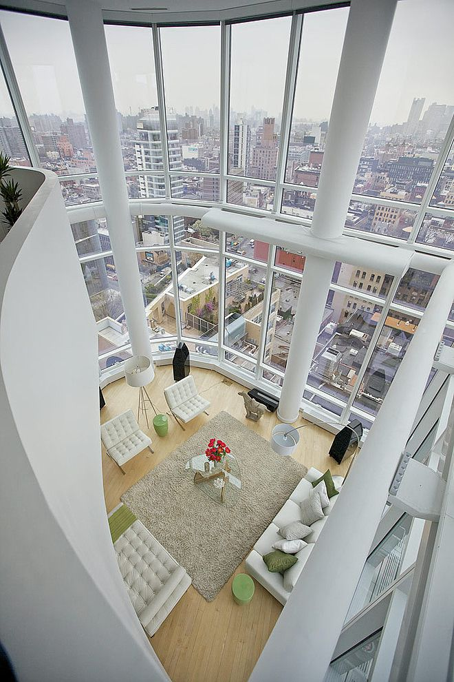 Chelsea Duplex Penthouse by Marie Burgos Design. This astonishing duplex penthouse has floor-to-ceiling glass walls with unparalleled views of Manhattan. It has been designed with a modern approach to create a welcoming home space as well as being a showcase of fabulous views.. Photography: Scott Morris