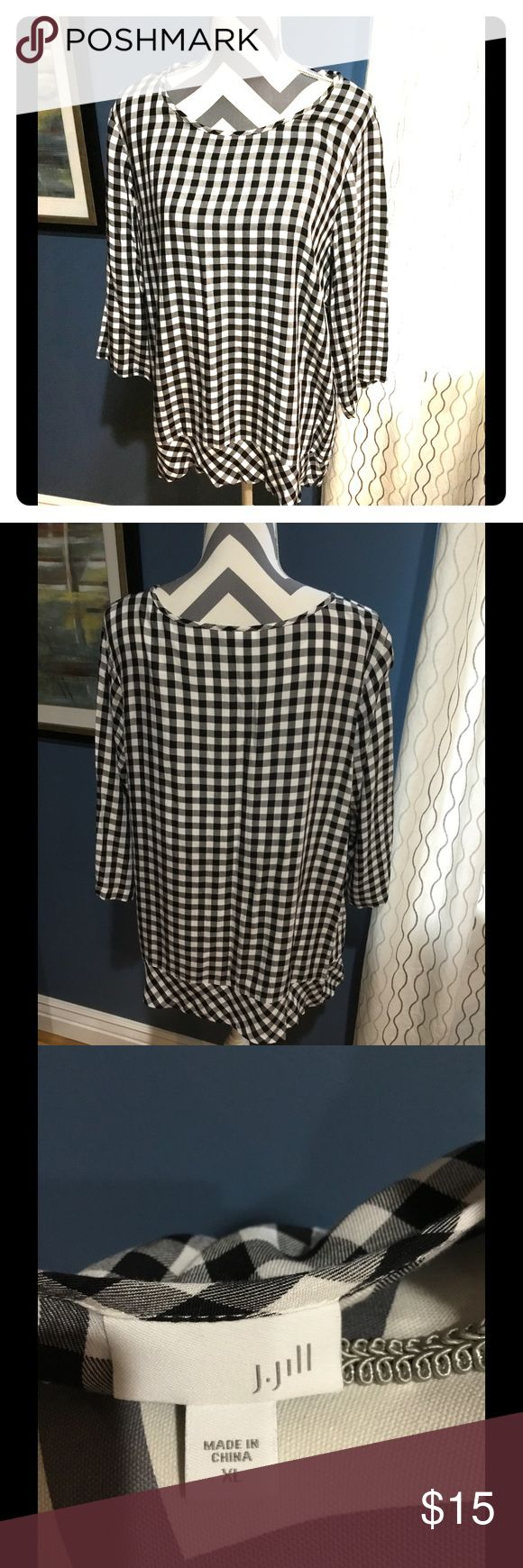 Ladies j Jill shirt Black and white  shirt. 3 quarter length sleeves. Small ruffle on bottom.  Excellent shape no tag but I don't remember wearing it. j jill Tops Blouses
