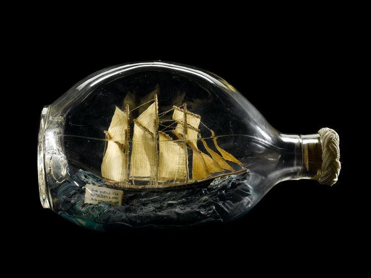 A dimple whisky bottle containing a model of the schooner 'Kathleen and May' 1900. British Maritime Museum.
