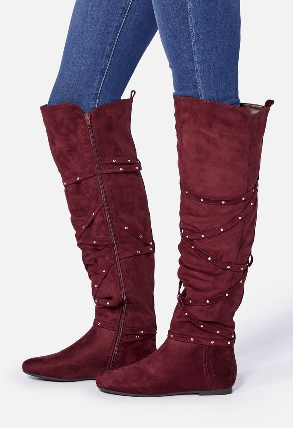 A lush and cozy faux suede boot featuring subtle stud accents and an inner zip closure....