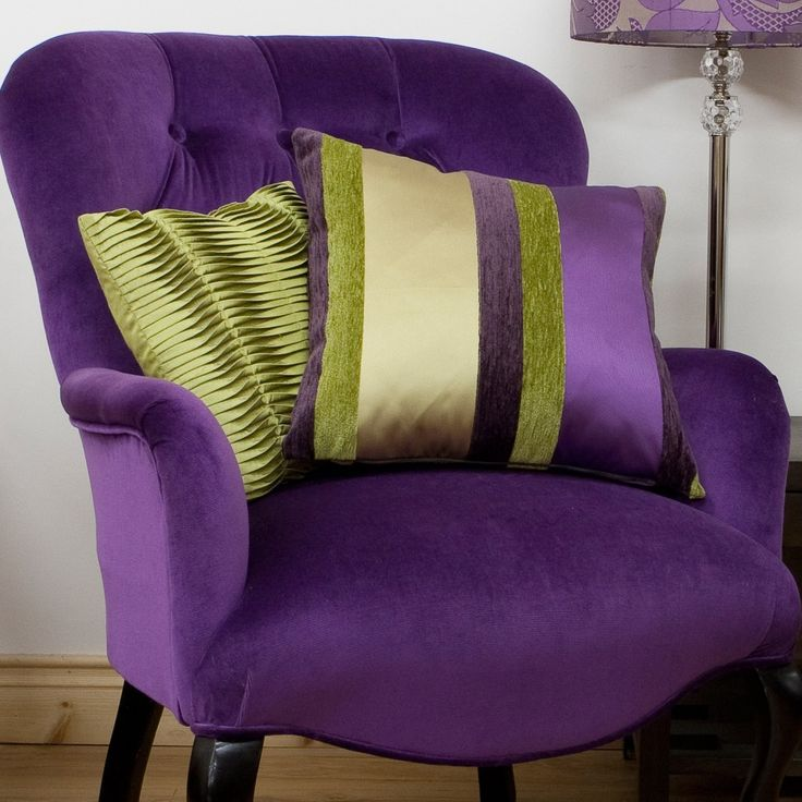 *looks at chair then at pillows* *Ditches the pillows and goes for the Purple chair*, who thinks it looks comfortble and purpled enough to squish into?     ;D